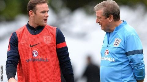 Wayne Rooney (left) and Roy Hodgson