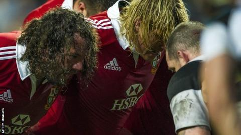 Sweat pours from the hair of Lions prop Adam Jones and hooker Richard Hibbard