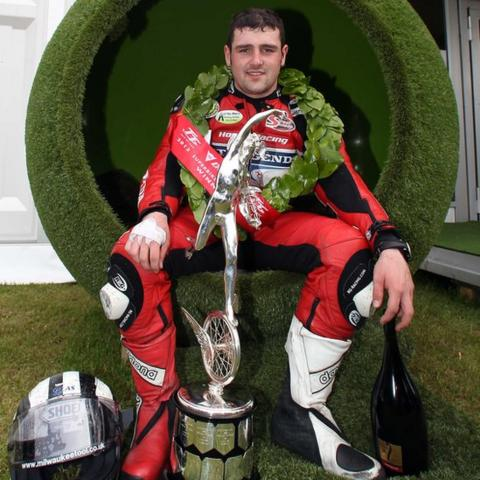 Michael Dunlop celebrates with the silverware after winning the Superbike race at the Isle of Man TT