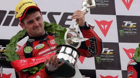 Michael Dunlop celebrates victory at the Isle of Man TT