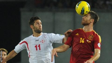 Xabi Alonso wins a header for Spain