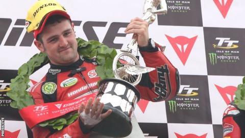 Michael Dunlop celebrates victory at the Isle of Man TT