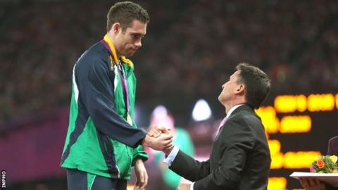 Jason Smyth receives his London Paralympics 200m gold medal from Lord Sebastian Coe last September