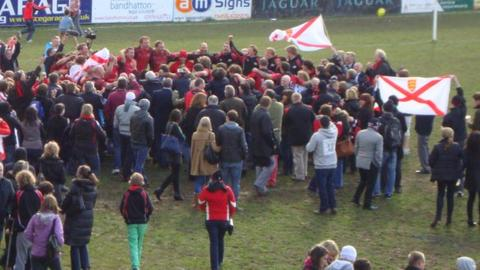 Jersey celebrate promotion at Coventry last April