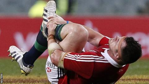 Cian Healy holds his ankle after sustaining his tour-ending injury