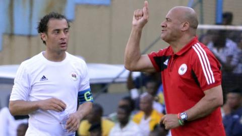Libya's coach Abdelhafidh Erbish (right) speaks to the team's captain Mohamed El Mughrabi