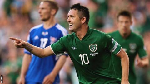 Robbie Keane celebrates his third goal