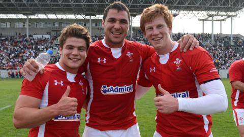 Try scorer Harry Robinson, Andries Pretorius and Rhys Patchell celebrate Wales' nail-biting 22-18 win over Japan in Osaka