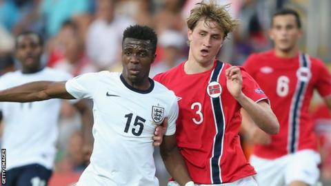 England Under-21s' Wilfred Zaha is challenged by Thomas Rogne