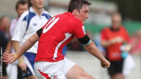 Sam Davies kicks a goal for Wales under-20