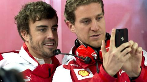 Ferrari driver Fernando Alonso and chief communications officer Renato Bisignani