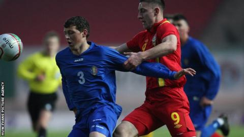 Wales U21 striker Jake Cassidy in action against Moldova