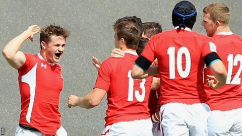 Wales U20 full-back Hallam Amos (left) celebrates his first-half try against Argentina