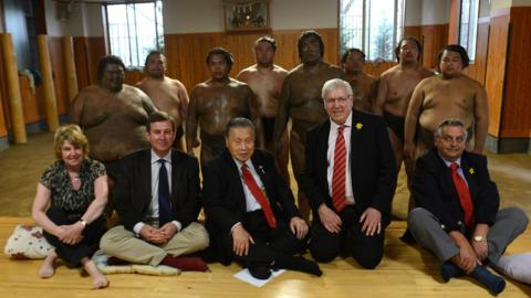 Welsh Rugby Union officials on a visit to a Sumo training centre in Tokyo. Seated are WRU chief executive Roger Lewis (seated, second left), Japanese Rugby Rugby Union president Yoshiro Mori, WRU president Denis Gethin and WRU District C representative Ray Wilton.