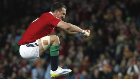 British and Irish Lions captain Sam Warburton warms up ahead of the tour match against NSW Waratahs in Sydney