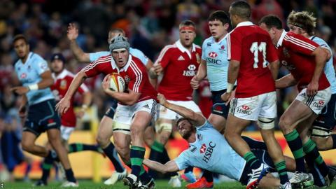 Centre Jon Davies launches another Lions attack against the Waratahs
