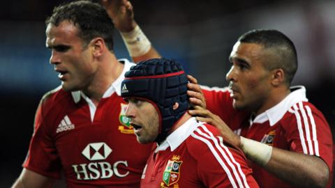 Wing Simon Zebo congratulates Wales pair Jamie Roberts and Leigh Halfpenny as the Lions dominate the Waratahs