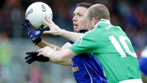 Cavan defender Ronan Flanagan battles for the ball with Erne forward Conor Quigley