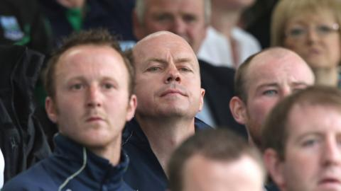 Fermanagh boss Peter Canavan watches from the stands as his team launches a second-half comeback
