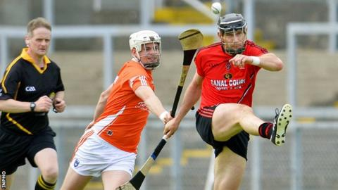 Armagh's Kevin McGarry challenges Declan Coulter in the quarter-final
