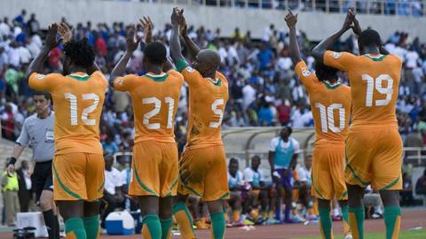 Ivory Coast players celebrate their progress to the third and final round of African qualifying.
