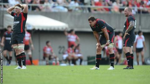 Wales forwards Andrew Coombs, Andries Pretorius and Craig Mitchell look dejected at the end of the game