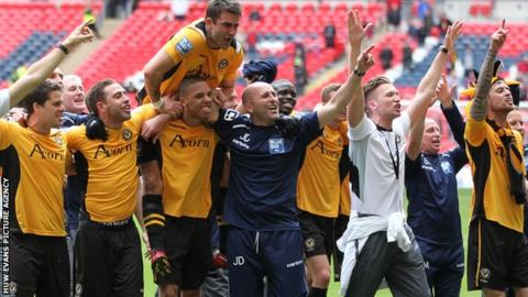 Newport players celebrate securing promortion at Wembley