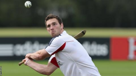 George North tries his hand at hurling after being declared fit to face the Wallabies