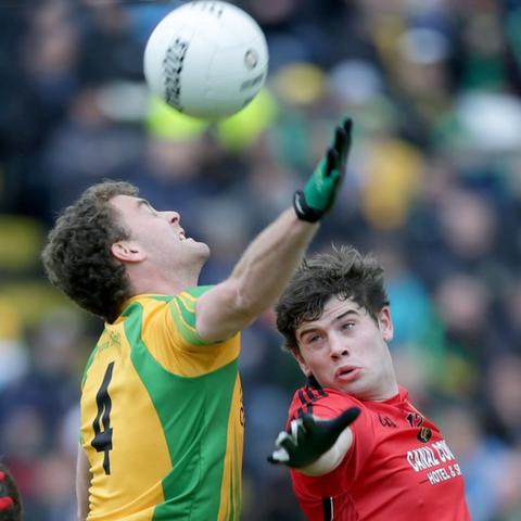 Eamonn McGee challenges Down opponent Niall Madine for a high ball in the Ulster semi-final which Donegal won 0-12 to 0-9