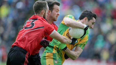 Conor Laverty and Mark Poland of Down attempt to halt the progress of Donegal's Rory Kavanagh