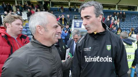 Europe's Ryder Cup captain Paul McGinley congratulates Donegal manager Jim McGuinness after the Ulster Championship semi-final at Breffni Park in Cavan