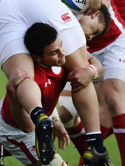Hooker Luke Cowan Dickie is tackled by Wales' flanker and captain Ellis Jenkins as England U20 fight back to win 23-15 and take the title in Vannes