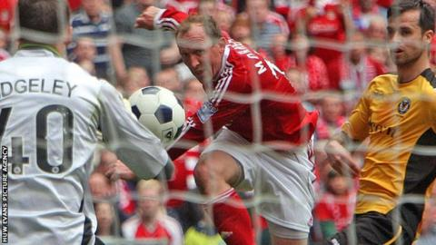 Andy Morrell takes a shot at goal in the Conference play-off final against Newport County at Wembley