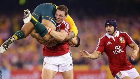 George North lifts Australia wing Israel Folau as Leigh Halfpenny looks on