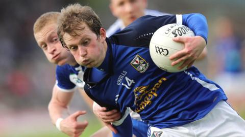 Cavan forward Martin Dunne attempts to move clear of Colin Walshe
