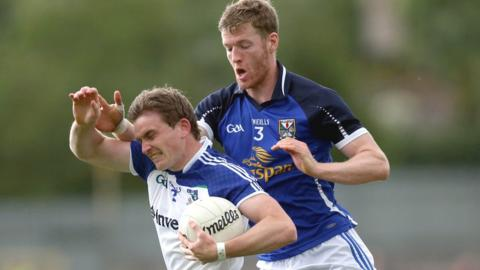 Monaghan defender Dessie Mone is challenged by Breffni opponent Rory Dunne