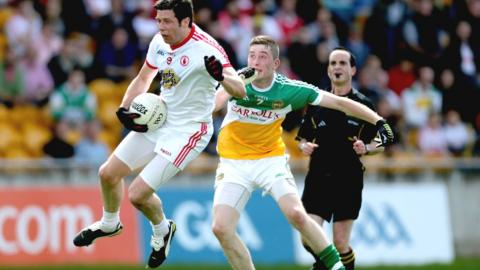 Red Hands midfielder Sean Cavanagh takes to the air to secure the ball ahead of David Hanlon in Tyrone's 1-27 to 0-8 hammering of Offaly