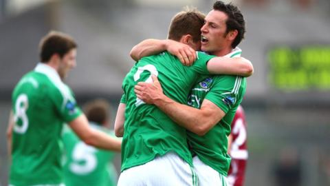 Fermanagh pair Damian Kelly and John Woods embrace at the final whistle following the 3-10 to 1-15 victory over Westmeath