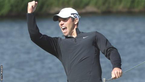 Paul Casey celebrates after holing for an eagle at the 18th