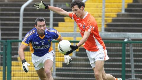 John McGrath attempts to close down Armagh forward Jamie Clarke, who scored both goals in a 2-21 to 0-2 rout of Wicklow
