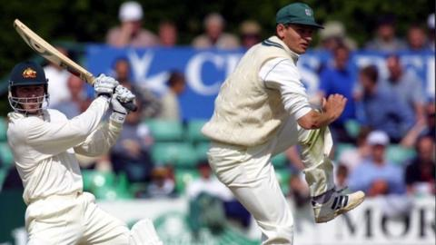 David Leatherdale takes evasive action from Australian batsman Damien Martyn