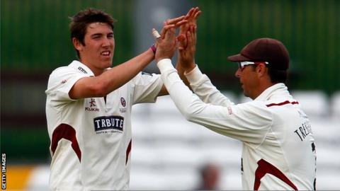 Jamie Overton celebrates with Somerset captain Marcus Trescothick after taking a wicket