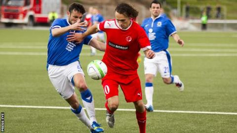 Linfield's skipper Michael Gault in action against IF Fuglafjordur
