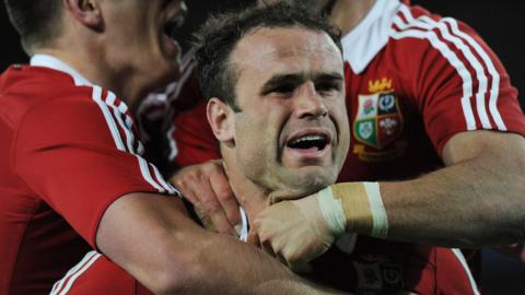 Jamie Roberts is hugged by team-mates after scoring his try in the Lions' 41-16 win over Australia in the deciding Test match in Sydney.