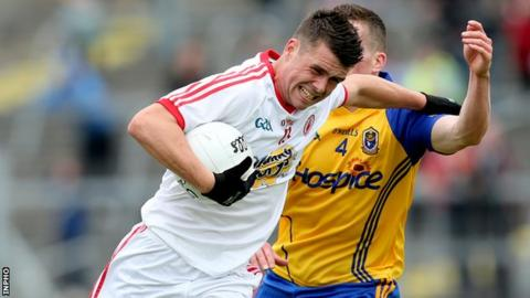 Tyrone's Darren McCurry tries to fend off Roscommon's Seanie McDermott
