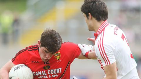 Down's Niall Madine shrugs off the challenge of Derry's Chrissy McKaigue during the qualifier clash
