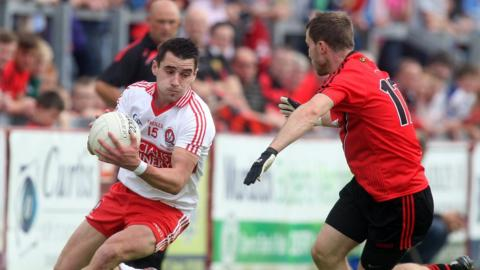 Lee Kennedy and Owen Costello in action as Derry beat Down 0-13 to 1-5
