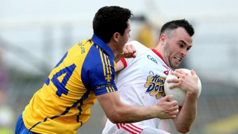 David O'Gara and Cathal McCarron tangle during Tyrone's win over Roscommon at Dr Hyde Park