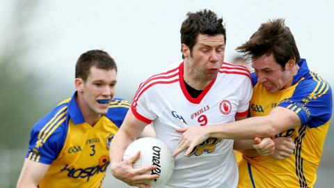 Sean Cavanagh and Niall Carty battle for possession in the All-Ireland Football Qualifiers second round tie