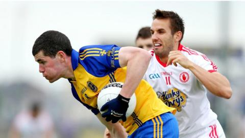 Roscommon's Cathal Shine wheels away from Mark Donnelly of Tyrone as the Red Hands secure a two-point win